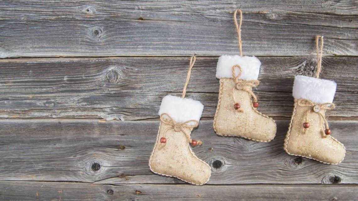 Three small stockings on a backdrop of wood