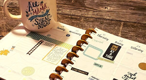 happy planner on a table