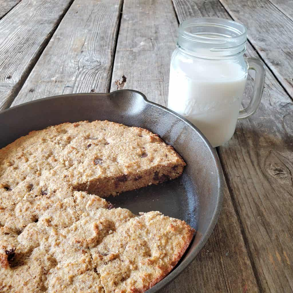 keto skillet cookie with milk on a table