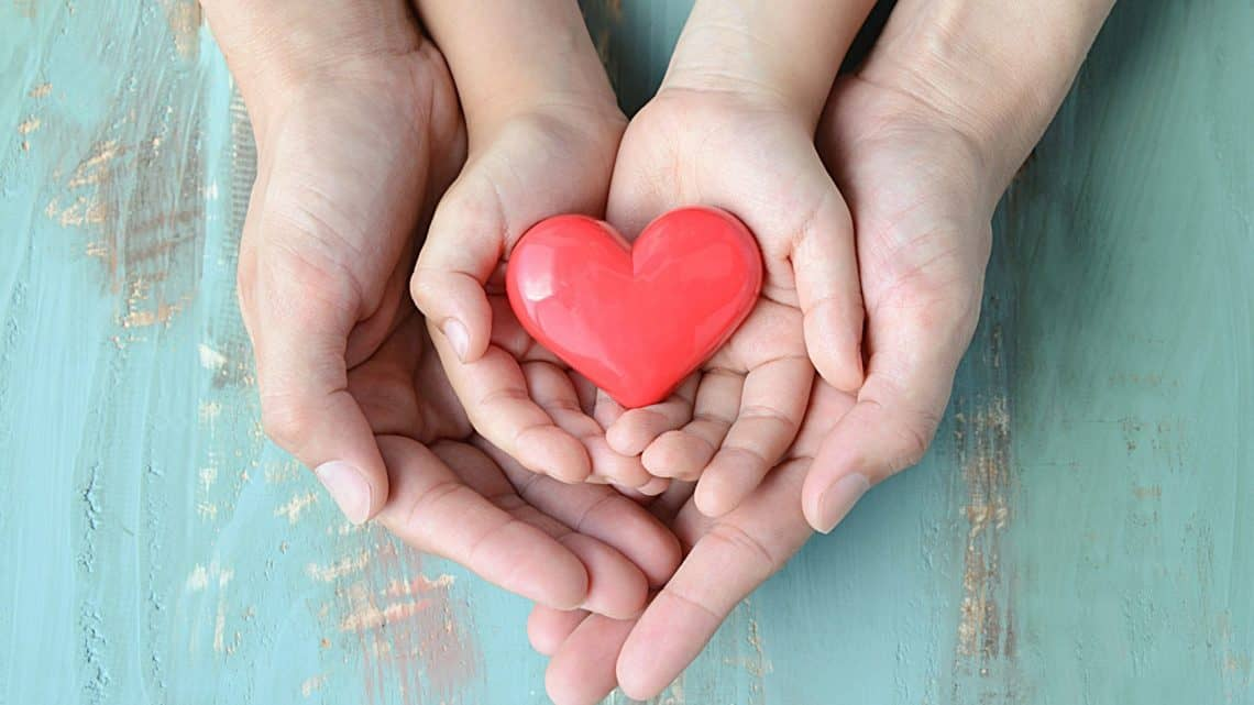 family with heart in their hands