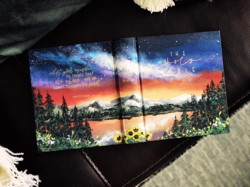 painted Bible with landscape and flowers