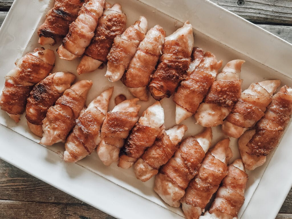easy bacon wrapped chicken on a tray